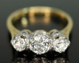 A three stone diamond ring, the Old European cut diamonds weighing approx. 0.30, 0.72 & 0.33 carats,