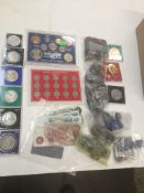 A box of mainly British coins and a bag containing 6 coin display cases