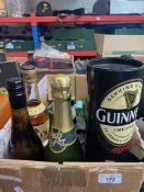 A box of alcoholic beverages to include Bell's whisky, Ouzo, Mirabelle, Babycham, Heineken, etc.