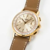 A GENTLEMAN'S 18K SOLID YELLOW GOLD LONGINES FLYBACK CHRONOGRAPH WRIST WATCH DATED 1969, REF. 7414