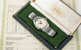 A GENTLEMAN'S STAINLESS STEEL ROLEX OYSTER PERPETUAL BRACELET WATCH DATED 1957, REF. 6564 WITH