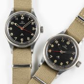 A SET OF TWO VERY RARE GENTLEMAN'S STAINLESS STEEL BRITISH MILITARY OMEGA RAF PILOTS WRIST WATCHES