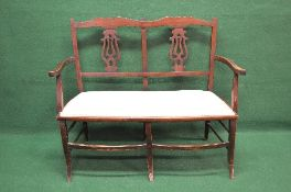 Edwardian two seater chair back settee the back having pierced back splats supported by scrolled