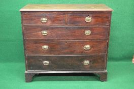 Georgian mahogany chest of drawers the top having moulded edge over two short and three long