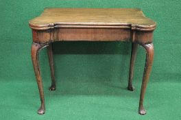 Georgian mahogany fold over card table the top opening to reveal green baized playing surface with
