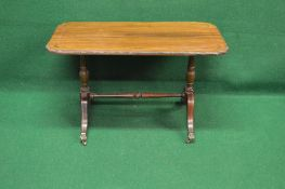 Rosewood occasional table the rectangular top having shaped corners with brass inlaid decoration