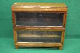 20th century oak two section Globe Wernicke bookcase having glazed up and over doors,