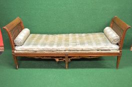 Large walnut window seat/day bed having scrolled slatted ends with removable seat cushion and