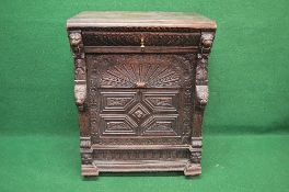 19th century oak carved side cabinet the top having moulded edge over single drawer with brass drop