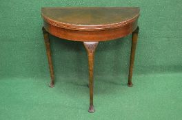 20th century mahogany demi lune fold over card table having cross banded top opening to reveal