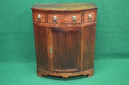 19th century mahogany bow fronted side cabinet the top lifting to reveal storage space over three