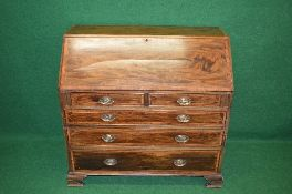 19th century mahogany and cross banded bureau having fall front opening to reveal fitted interior