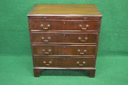 20th century mahogany chest of drawers the top having moulded edge over brushing slide with brass