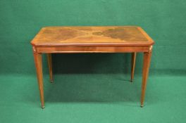 20th century mahogany cross banded occasional table having rectangular top with cut corners over a