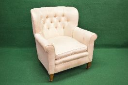 Buttoned back tub style armchair with scrolled arms and removable seat cushion with straight front,