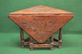 Oak carved drop leaf corner table the top having carved decoration of baskets of flowers with a