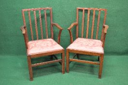 Set of six oak Georgian style armchairs having vertical back rails supported by moulded uprights