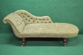 Victorian mahogany upholstered chaise longue having green buttoned upholstery and standing on four