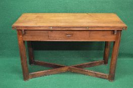 Mahogany fold over dining table the top having two fold over leaves with military style hinges over