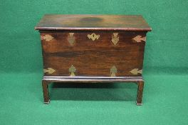 Mahogany chest on stand having brass mounts, escutcheon and side carrying handles,