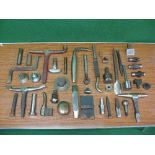 Quantity of approx forty heavy dollies and three hammer heads, mostly stored in oil soaked cling