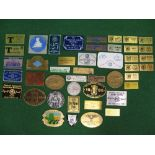 Quantity of brass, plastic, cast and enamel rally plaques from around the world Please note
