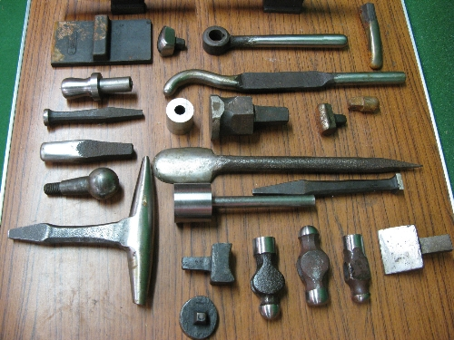 Quantity of approx forty heavy dollies and three hammer heads, mostly stored in oil soaked cling - Image 3 of 6