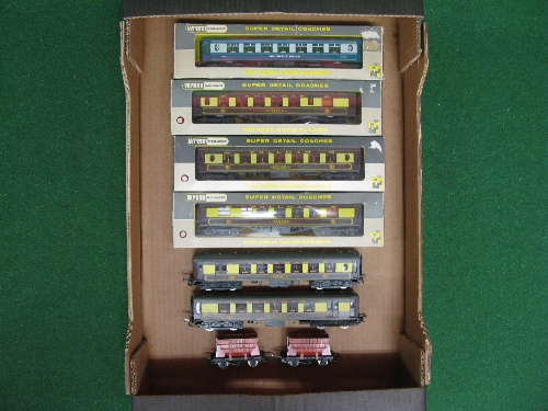 Wrenn chocolate and cream Brighton Belle cars No. 90 and 91 together with two bulk cement wagons,