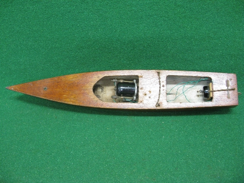 """Wooden speed boat with early un-enclosed electric motor, propeller, rudder and on/off switch - 25"""""""