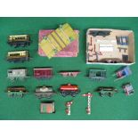 Quantity of Hornby O gauge tinplate items to include: two Pullmans, eight wagons, signal arms, plate