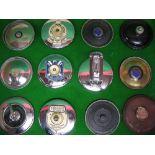 Twelve barnacle etc tax disc holders for garages in Dumfries, Birmingham, London, Leicester,
