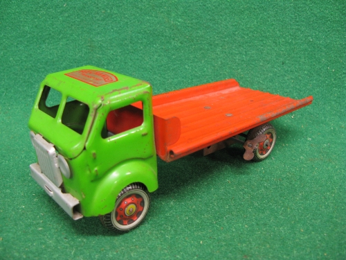 Clockwork tinplate flat bed lorry finished in green and red livery with Mechanised Transport Made In