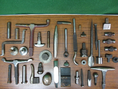 Quantity of approx forty heavy dollies and three hammer heads, mostly stored in oil soaked cling - Image 2 of 6