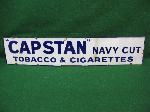 Enamel advertising sign for Capstan Navy Cut Tobacco & Cigarettes, dark blue letters and border on a