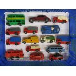 Approx fifteen clockwork or friction drive plastic bodied cars, lorries, buses and steam engines