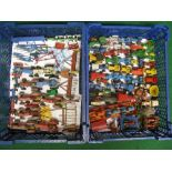 Two crates of approx eighty playworn model tractors and farm implements from various manufacturers
