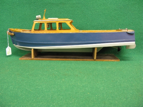 Bespoke wooden model of a classic shaped open backed motor launch with rudder, prop and stand (power