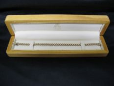 9ct gold and Diamond tennis bracelet each link being set with a round cut Diamond and having snap