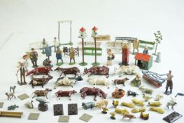 Quantity of mid 20th C metal farm figures, animals and accessories to include Britains, Hornby etc