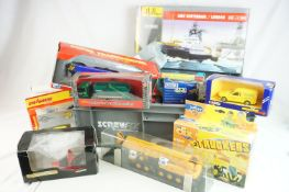 22 X Boxed, carded and cased diecast construction and emergency services models to include 7 x Tesco