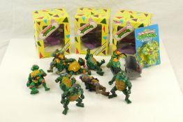 Five playworn Playmates Teenage Mutant Ninja Turtles action figures and vehicles to include