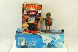 Boxed Saturn robot, showing signs of playwear and missing sticker, plus boxed Discovery Shuttle