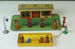 Mid 20th C tin plate garage with petrol pumps, made in England, with Tecalemit logo to front of