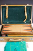 A vintage cased games compendium including back gammon and roulette wheel etc