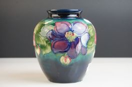 Moorcroft Globular Vase in the Clematis pattern on a green ground, Moorcroft signature to base and