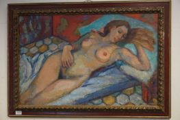 A 20th century oil on canvas of a recumbent nude women 56 x 87 cm initialled A E C.