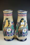 Pair of Amphora Vases of baluster form, painted in coloured enamels with birds and foliage, marked