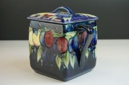 Moorcroft Biscuit Barrel in the Wisteria pattern on a blue ground, restoration to lid, Moorcroft