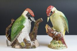 A Beswick Green Woodpecker figure impressed number 1219 green paper label together with a Royal