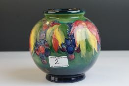 Moorcroft Globular Vase in the Berry & Leaves pattern on a green ground, impressed facsimile